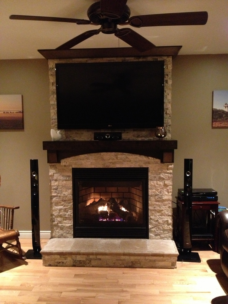 Stone on fireplace with tv mounted over mantle for Fireplace no mantle