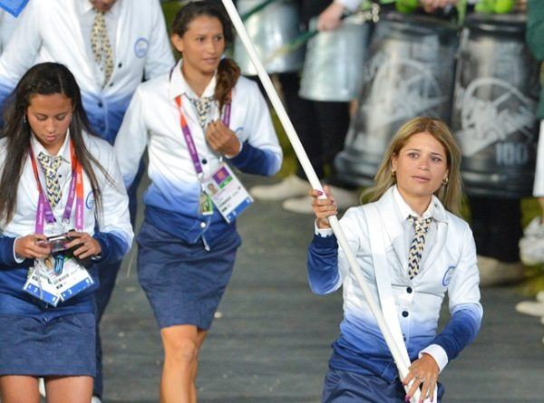 Team El Salvador, London Olympic Opening Ceremony > El Salvador for the win! We're shooing these athletes straight to the victory podium for adding a touch of real-world style to their Olympic uniforms with these ombré sweaters and fitted blue skirts. World-class athlete or Excel whiz, who wouldn't wear this to work Monday morning? (Via The E! Fashion Police)