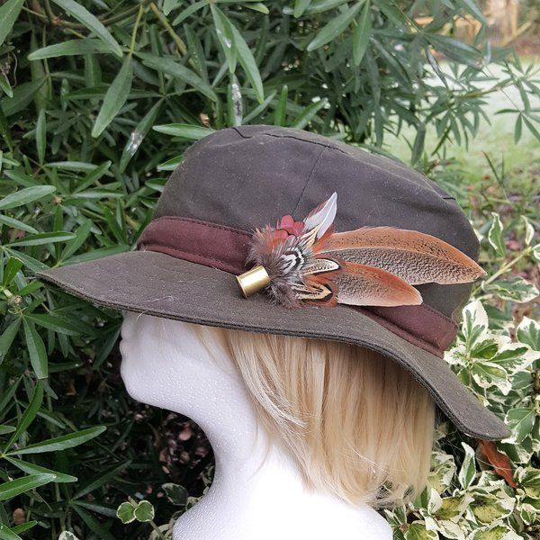 pheasant feather in 410 cartridge. hatpin/ brooch http://countrycraftybits.co.uk/