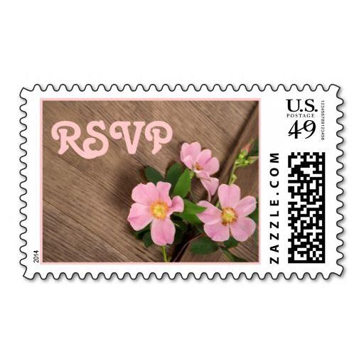 Pink wild dog roses on wood rustic wedding RSVP postage stamp. #wildrose, #wood, #pink, #rustic, #wedding, #RSVP, #postagestamp, #stamp, #dogrose