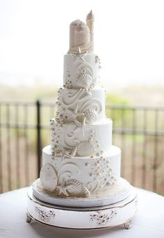 incredible 4 tier beach wedding cake with edible sand castle cake topper - love this one! ~ we ❤ this! moncheribridals.com