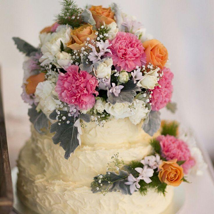 Wedding flowers on homemade cake