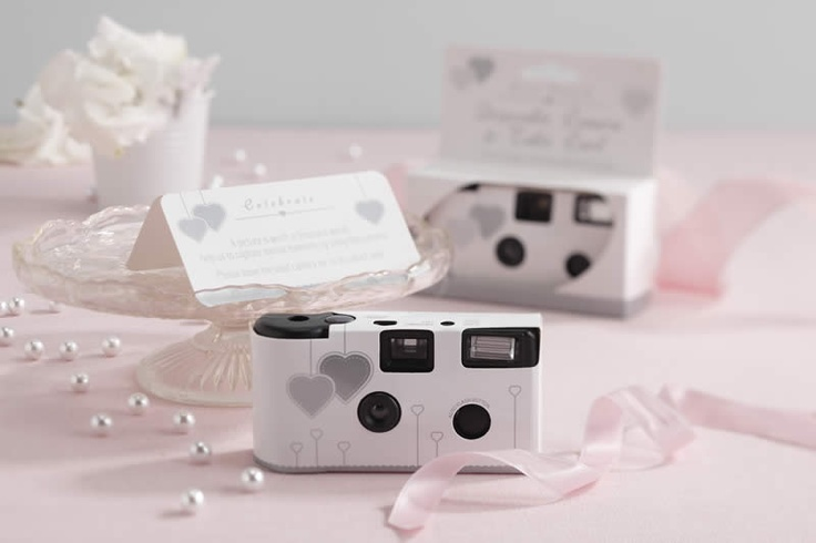 A picture's worth a thousand words! Use these white and silver, heart design, disposable, single use cameras to capture special moments. Each camera comes with a built in flash, a 27 exposure film and matching table card.
