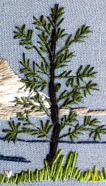 embroidered landscape in close-up.