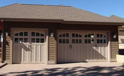 Carriage Doors; curved and three panel, one single garage door and one double garage door.
