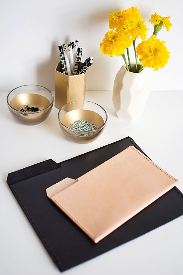 Chic and stylish office supplies- black and natural file folders perfect for holding papers, tablets, and e-readers.
