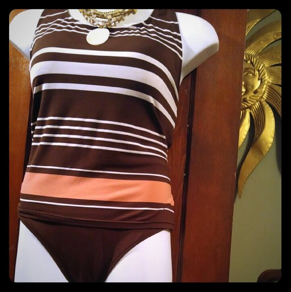 Sand N Sun Brown Tankini W/High Waisted Briefs 3X Super cute multi-colored tankini with high waisted briefs. I LOVE this suit! It fits a 2X - 3X the best but if you yo-yo like me, it continues to fit and look good. Super easy to care for, just throw it in the wash or rinse and hang dry, built in padded bra lends good support to large chests. Sand N Sun Swim Bikinis