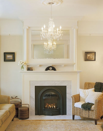 Beautiful!  This is a Valor gas fireplace with a carrara marble surround. The mirror above was original to the Victorian house.