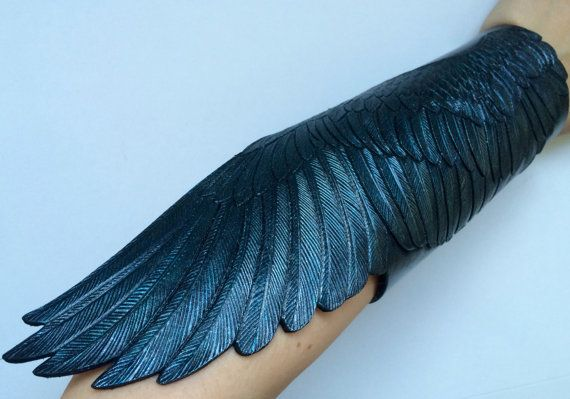 Fantasy tooled leather bracers Gamayuns wings: a pair of hand tooled and hand painted black leather wings with iridescent silver-blue-green