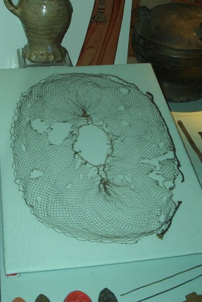 Early to mid 14th century silk hair net. Museum of London