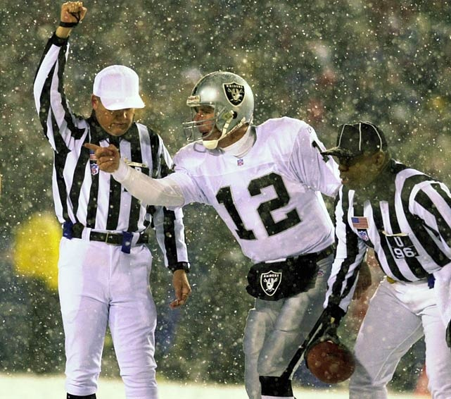 Quarterback Rich Gannon #12 complains to referee Walt Coleman. This was a picture taken from the infamous Tuck Rule game.