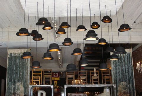 Mens felt hats used as hanging lights