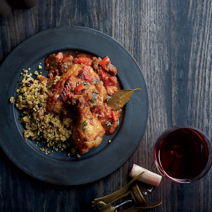 Braised chicken in smoky tomato sauce with currant-studded couscous makes for a great meal. Get the recipe from Food & Wine.