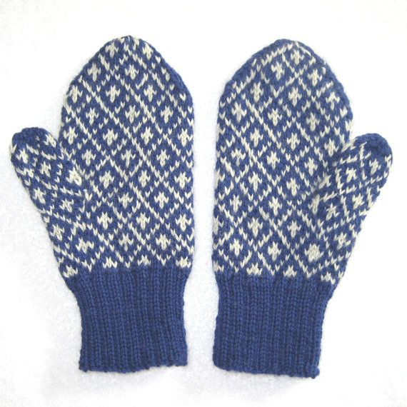 These are very warm, hand knit, wool mittens in a Nordic pattern of blue and white. They will. keep your hands warmer than acrylic and if they get slightly wet, your hands will stay warm. And dont, wool is eco-friendly.  The pattern is of Fleur-de-lis inside diamonds, a classic Scandinavian pattern. They are also extra warm because the design uses two colors and the unused one is carried along inside, making them doubly thick.  Put a little something special on your hands where you can keep…