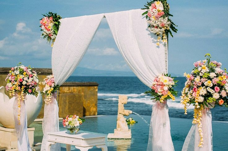 We loved the contrast of the bright flowers with the brilliant blue sky.  #beachwedding #weddingdecorations #weddinginbali #brides #balibride #weddingdestinations #balihappyevents  #weddinginspirations #weddingideas #baliweddingplanner #baliweddings #baliweddingorganizer  #weddingplanners #weddingorganizer #instainspo Contact us a for a stress-free wedding planning experience. grazyna@balihappyevents.com (Europe) arsih@balihappyevents.com (Asia & Australia)