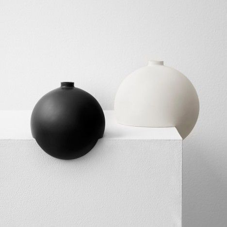 Tumble vases by Falke Svatun balance on the edge of shelves or windowsills