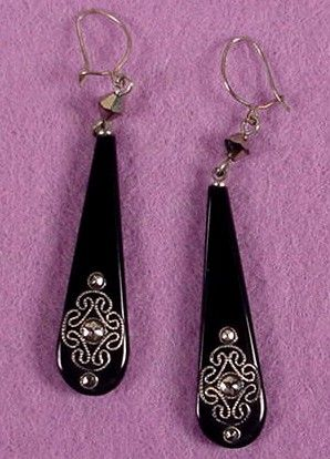 "Fine black glass drops are decorated with sterling silver wire in a dainty pattern. Each earring has three marcasites at the bottom and a Venetian crystal bead at the top. Very sleek in their simplicity. 2 3/4"" long including wires, the black drop is 1 3/4"" long and 1/2"" wide."