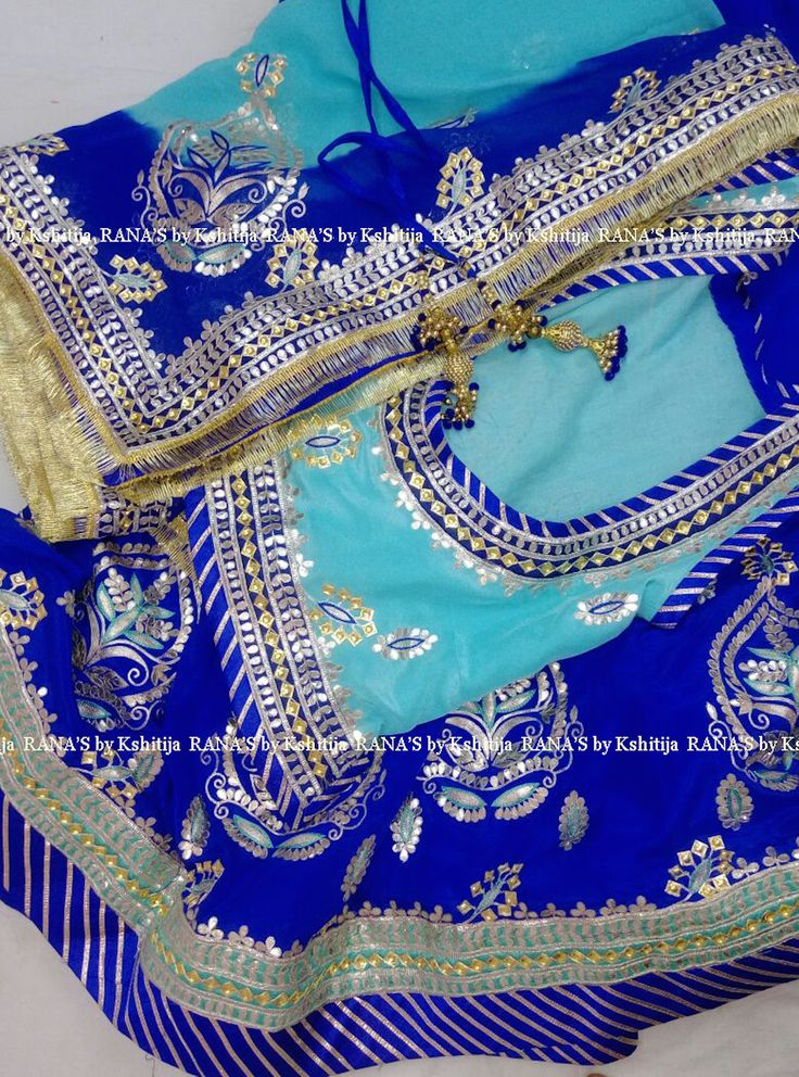 Rajputi poshak - combination of  gorgeous blues, aari, resham, gota and danka handwork. At RANA'S by Kshitija we specialise in designer handworked clothing for bridal and wedding wear. Reach us at: +917023953082 or www.ranasaree.com