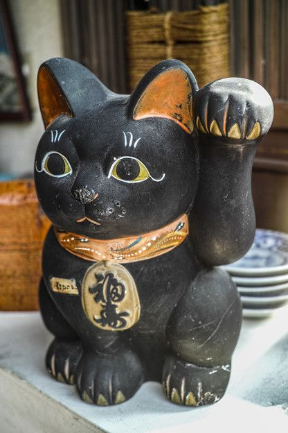 A black maneki neko (lucky cat). Black cats are considered lucky in Japan.