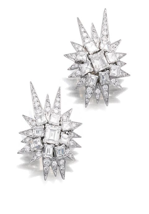 PAIR OF DIAMOND EAR CLIPS, SUZANNE BELPERRON, CIRCA 1960 Each designed as a star burst, set to the centre with step-cut diamonds, the rays set with circular- and single-cut diamonds, French assay and maker's mark for Darde & Fils.