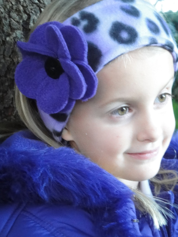 JorJa fleece headband ear warmer in purple cheetah with two purple button on flowers. $14.00, via Etsy.