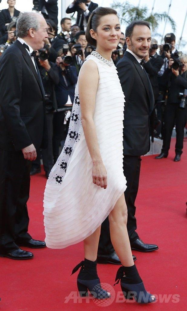第67回カンヌ国際映画祭(Cannes Film Festival)で主演映画『Deux Jours, Une Nuit』の公式上映に出席した女優のマリオン・コティヤール(Marion Cotillard、2014年5月20日撮影)。(c)AFP/VALERY HACHE ▼26May2014AFP|<第67回カンヌ国際映画祭>「クリスチャン ディオール」を着用したセレブをチェック! http://www.afpbb.com/articles/-/3015602 #Cannes_Film_Festival_2014 #Marion_Cotillard