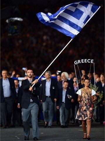 The Greek Olympic team enters the Olympic StadiumTaekwondo athlete Alexandros Nikolaidis of Greece carries his national flag into the stadium during the Opening Ceremony of the London 2012 Olympic Games at the Olympic Stadium on 27 July 2012