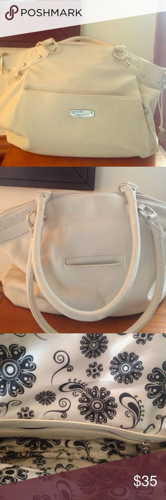 Grace Adele Satchel Cream Grace Adele Satchel with Silver toned accents. Black and white paisley inside. Normal Wear on straps but in In great condition Grace Adele Bags Satchels