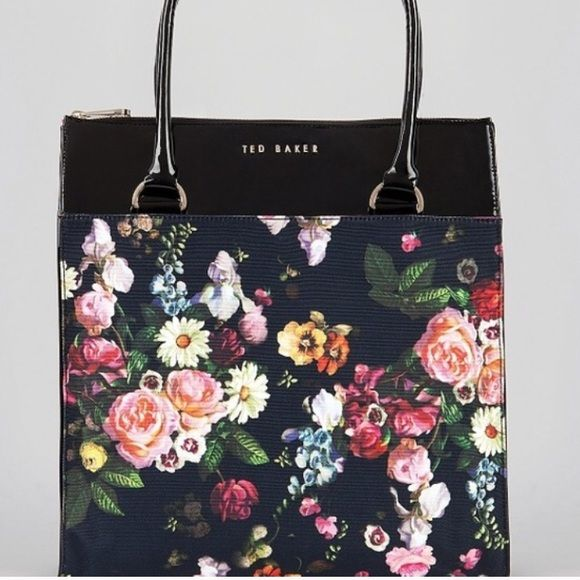 """TED Baker KOOLA Shopper Tote Like New Like new. Sold Out TED Baker KOOLA Shopper Tote A sweet floral print meets the structured silhouette of this Ted Baker tote, making this the perfect chic-girl carryall.  Polyurethane; lining: cotton Spot clean Imported Double top handles Zip closure; lined Interior zip pocket Logo on front 13""""L x 3.1""""W x 14.2""""H; 10.2"""" handle drop Ted Baker Bags Totes"""