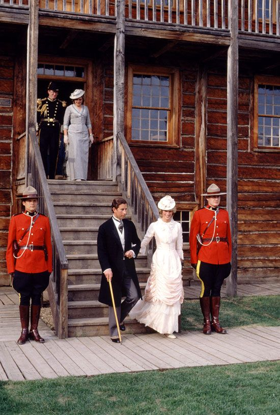 Princess Diana and Prince Charles in historic dress - Anne Beckwith Smith on the stairs behind them