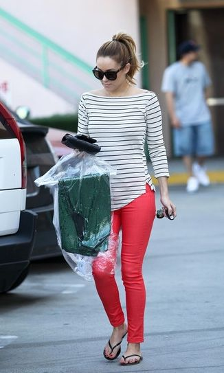 Get Lauren Conrad's look: bright red bottoms, striped blouse with flip-flops or fashionable sandals. Finish the look with a clutch or crossbody purse and sunglasses