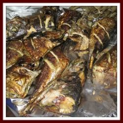Cameroon Food: Roasted fish. This is very common in Cameroon. Many women earn a living by roasting fish along the streets in major cities. Roasted fish is a delicacy and in very high demand, especially in the evenings and late into the night.