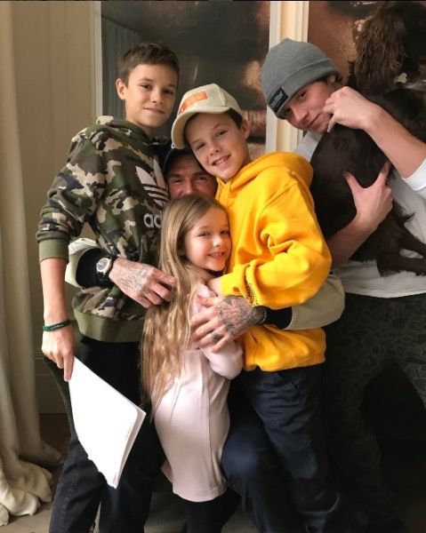 """Victoria Beckham took to Instagram to share a sweet photo of her husband David Beckham and their four children, Brooklyn, Romeo, Cruz and Harper, on Monday (Jan. 30). """"I think they love him! We you @davidbeckham X VB ,"""" she captioned the shot in which David"""