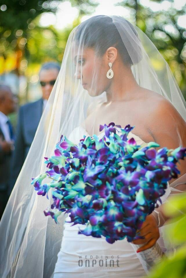 Blue Orchids Are Not Naturally But Dyed To Achieve The Purple Color Stunning Against A Wedding Dress Available At Tillie S Flower