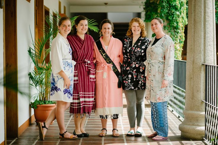 The morning of the wedding in Antigua, Guatemala, the Bride (center) and Bridesmaid (2nd from left) wore custom-made, handloomed, organic cotton robes from #jennifershamam #bridal #bridesmaids #wedding #robes #textiles #organiccotton (Photo: www.ontheroad.photo)