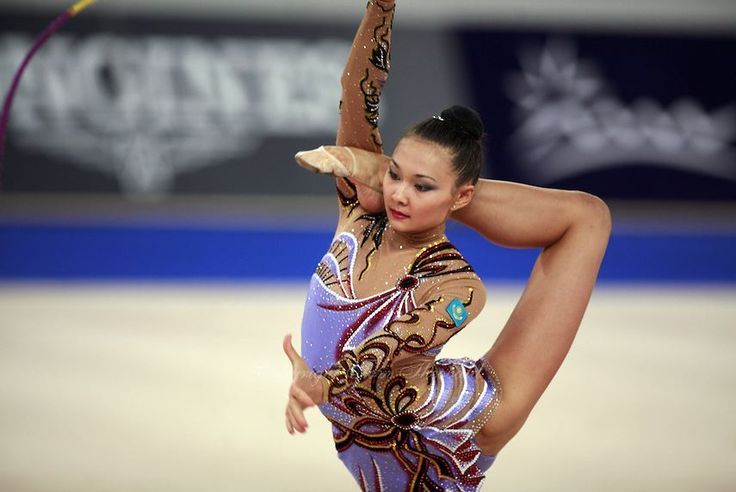 September 21, 2007; Patras, Greece; Aliya Yussupova of Kazakhstan balances in ring position with rope during All-Around final at 2007 World Championships Patras. Aliya placed 6th in the AA and helped Kazakhstan to receive one position for the individual All-Around competition at Beijing 2008 Olympics. Photo by Tom Théobald @Copyright 2007 by Tom Theobald