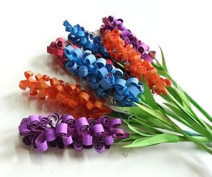 D.I.Y. Swirly Paper Flowers I would use all blue as they look like grape hyacinth