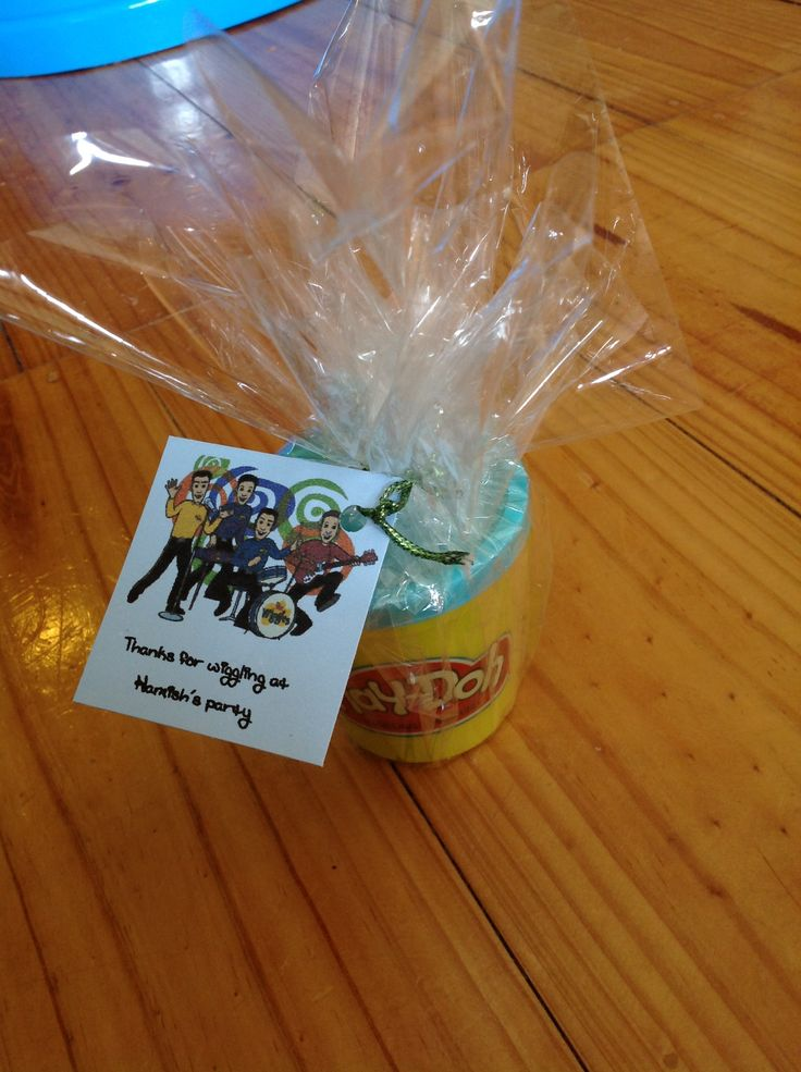 The wiggles birthday party theme. Thank you for wiggling at hamish's party. Kids thank you favours, instead of lollies or cheap plastic toys that only get thrown out, play doh wrapped in celephane and thank you tag. I just printed the tags from word on the computer and tied them wrapped with cellophane cut to size.   The wiggles party favour gifts.