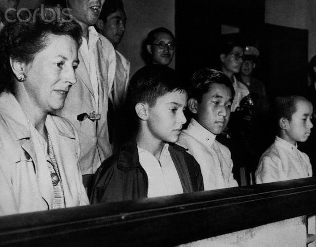 Arthur MacArthur, the son of General Douglas MacArthur, and Prince Akihito, the son of Emperor Hirohito, meet at a Tokyo swim meet.General Douglas Macarthur, Tokyo Swimming, Swimming Meeting, Emperor Hirohito, Prince Akihito, Arthur Macarthur