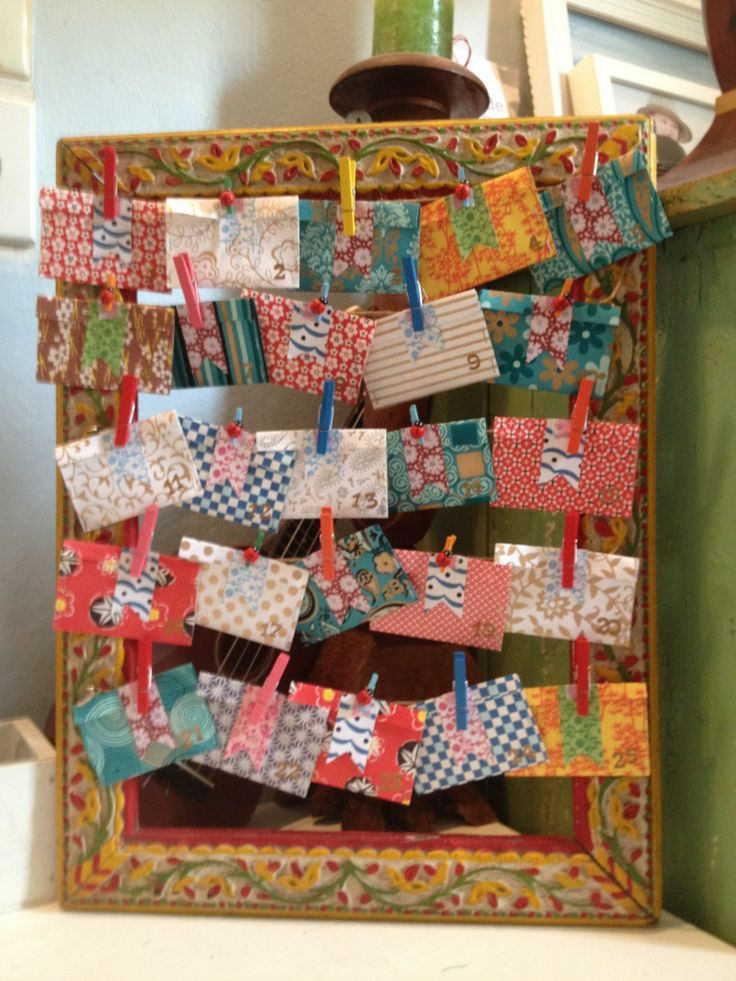 A coastal Christmas advent calendar from a salvaged frame and paper scraps. Just my style at www.mittymalou.com