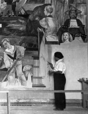 Lucia working on the Building of the Morning Star mural