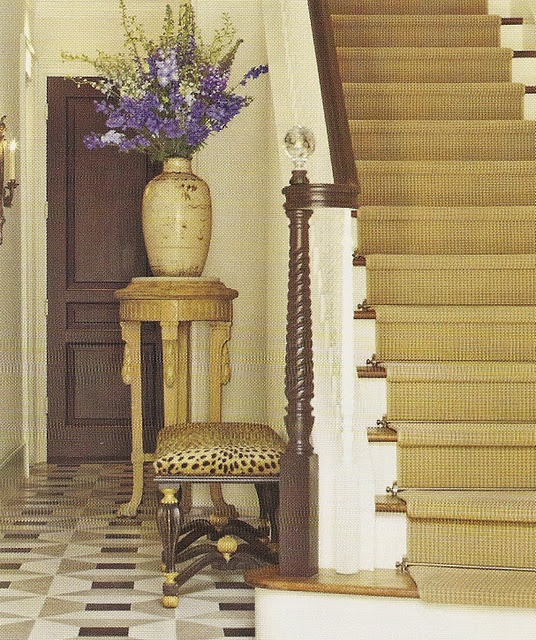 Love the runner and brass stair rods, newel post, leopard bench, pedestal and urn.