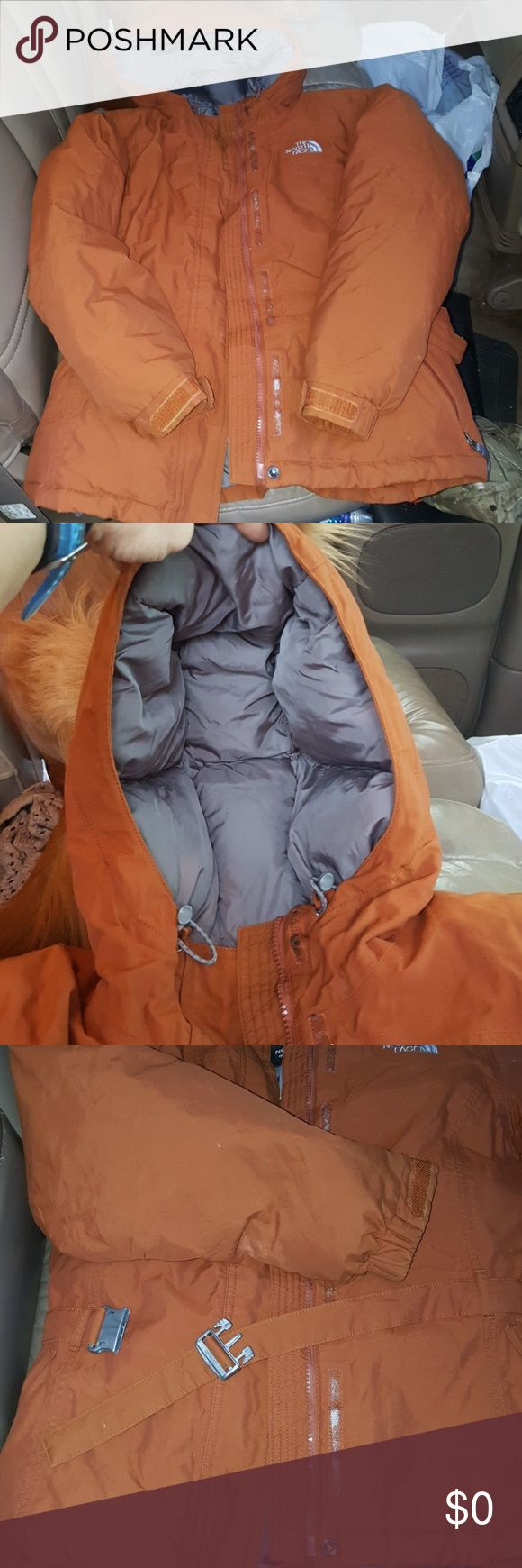 North Face/550 Goose Down Coat Ladies Medium. Great condition. Tons of life left. No holes or stains, nothing. Burnt orange color with quilted grey interior. Snap belt thats adjustable, waterproof exterior, Zipper hand pockets. Inside chest pocket. Mp3 holder/cell with headphone holder wtc... the coat is very warm. Hood doesnt come off. Shell is nylon. [One issue right now is that i cant find the fur that should attach to hood] price will be reflected. Any fur with a zipper can work. Goose…