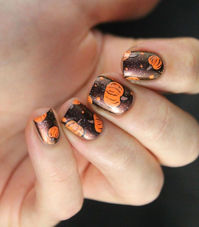Digging the pumpkin space vibes of this mani.