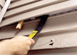 REPLACING DAMAGED VINYL SIDING    Project Difficulty: Easy  Estimated Project Time: 1 hour        	  Tools and Materials:  Replacement vinyl siding   Ladder, as needed   Zip tool   Wedges   Pry bar   Tape or scraps of thin wood   Metal snips   Utility knife   Hammer   Galvanized nails   Nail set