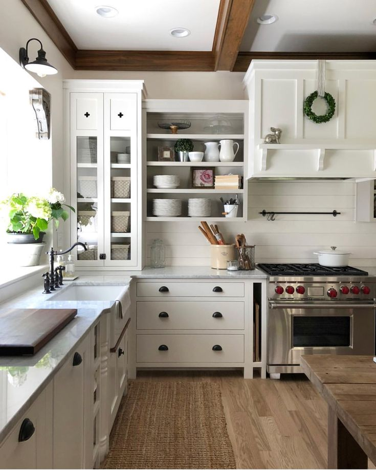 Best Brown Crown Moulding And Beams In White Kitchen With Black 400 x 300
