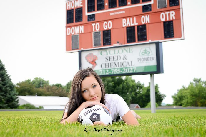 2014 High School Senior girl inspiration for sports posing. Soccer pose on the high school soccer field. High school senior pictures with a socceror any type of sport.