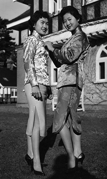 Supermodels of the day. Rose Wou and Lily Ning, trainees of British Overseas Airways Corporation, Jan. 16, 1955. (Folb/Topical Press Agency/...