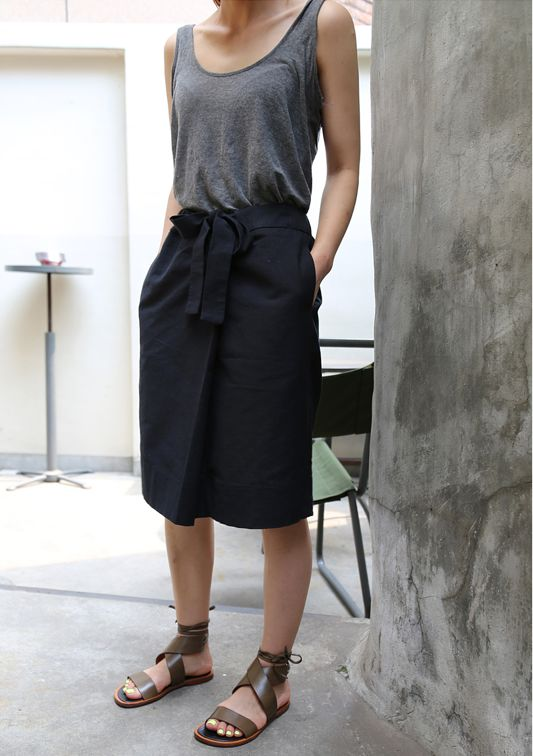 Love the skirt with pockets and the strappy flat sandals. tank is too low cut for me but i like the idea of it