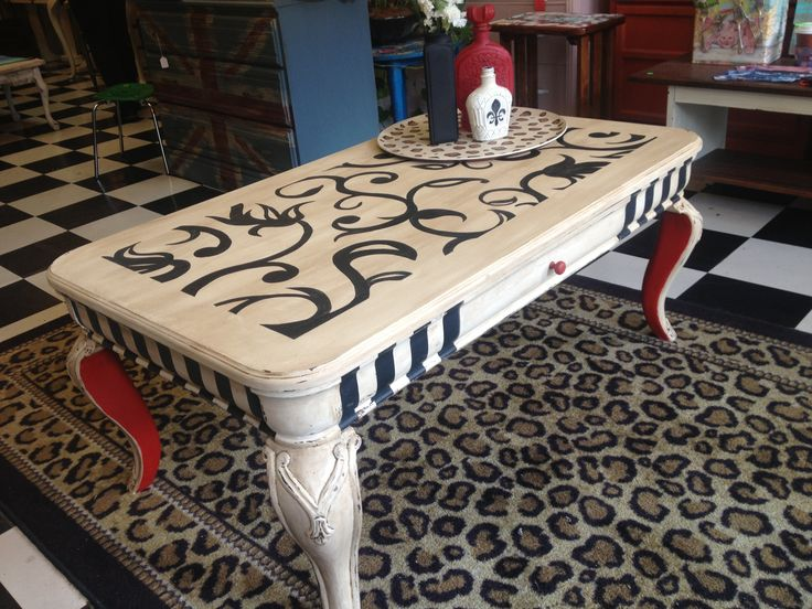 The legs of this table were inspired by Louboutin shoes with the red soles!
